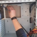author installing cooling fan in a computer case