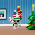 Photo of LEGO art: Star Wars stormtrooper bringing gifts to the tree. See citation at bottom of post.