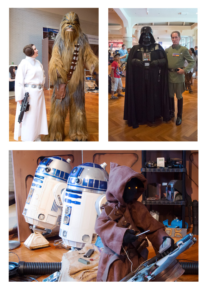 Star Wars cosplayers and figures. Top Left – Princess Leia and Chewbacca; Top Right – Darth Vader and Imperial Officer; Bottom – Two R2-D2 droids and a Jawa.