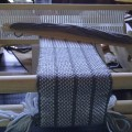 woven cloth on small, table-top loom